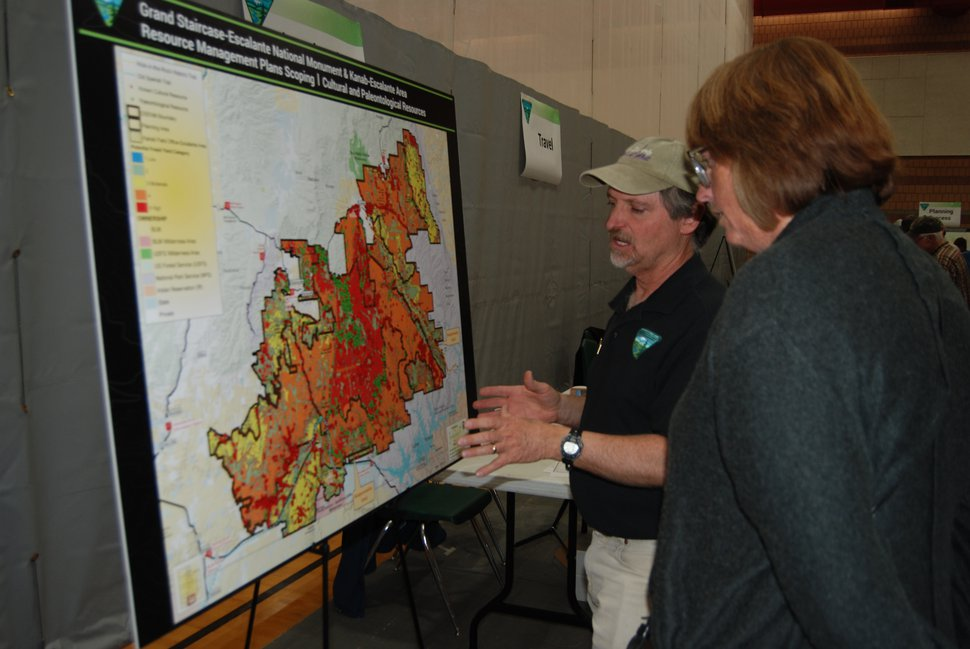 BLM paleontologist Alan Titus Tourists on Wednesday describes some of the dinosaur fossils the Grand Staircase-Escalante National Monument during a public meeting in Kanab. The Bureau of Land Management is developing plans for managing the 900,000 acres in Utah's Kane and Garfield counties that President Donald Trump stripped from the monument, as well as the 1 million acres that remain. Photo by Brian Maffly, shot March 28, 2018
