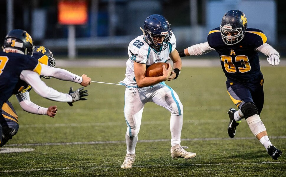 (Trent Nelson | The Salt Lake Tribune) Juan Diego's Tristen Tonozzi runs the ball. Summit Academy faces Juan Diego High School in a class 3A state semifinal football game at Weber State University's Stewart Stadium, Saturday November 4, 2017.