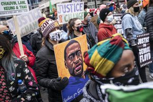 (John Minchillo | The Associated Press) Demonstrators gather during a rally outside the Hennepin County Government Center before the murder trial against former Minneapolis police Officer Derek Chauvin in the killing of George Floyd advances to jury deliberations, Monday, April 19, 2021, in Minneapolis.