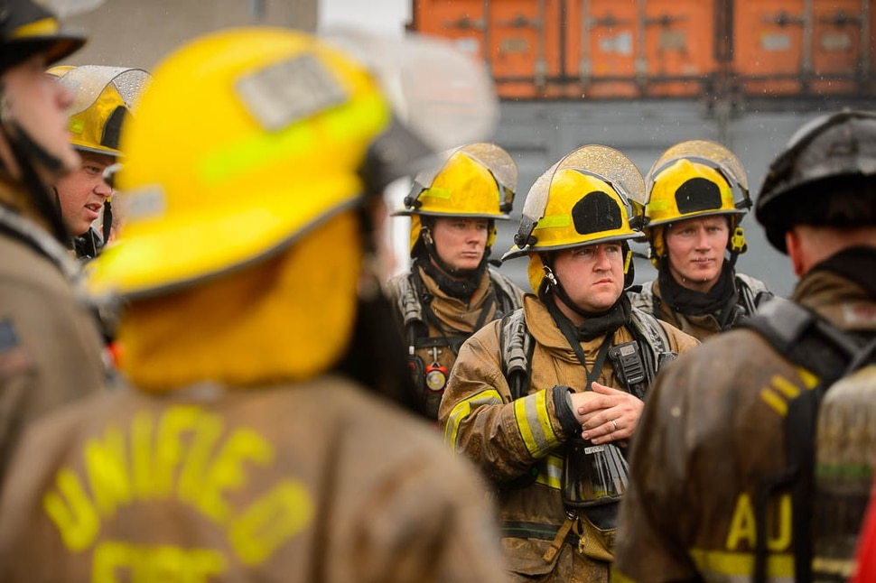 (Trent Nelson | The Salt Lake Tribune) Unified Fire recruits debrief after a live response to a vehicle and structure fire at the Unified Fire Authority Training Center in Magna on Tuesday April 16, 2019.