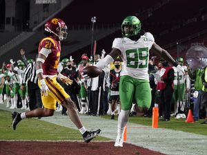 (AP Photo/Ashley Landis) | Oregon tight end DJ Johnson (89) runs to the end zone for a touchdown against Southern California safety Isaiah Pola-Mao (21) during the first quarter of an NCAA college football game for the Pac-12 Conference championship last year. New Pac-12 commissioner George Kliavkoff says fixing the Pac-12's football product and standing is Priority One has he gets ready to replace Larry Scott.
