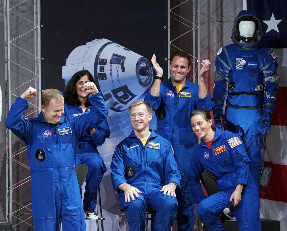 (AP Photo/David J. Phillip) Astronauts, from left, Eric Boe, Sunita Williams, Christopher Ferguson, Josh Cassada and Nicole Mann react after being introduced at a NASA event to announce them as astronauts assigned to crew the first flight tests and missions of the Boeing CST-100 Starliner and SpaceX Crew Dragon, Friday, Aug. 3, 2018, in Houston. The astronauts will ride the first commercial capsules into orbit next year and return human launches to the U.S.