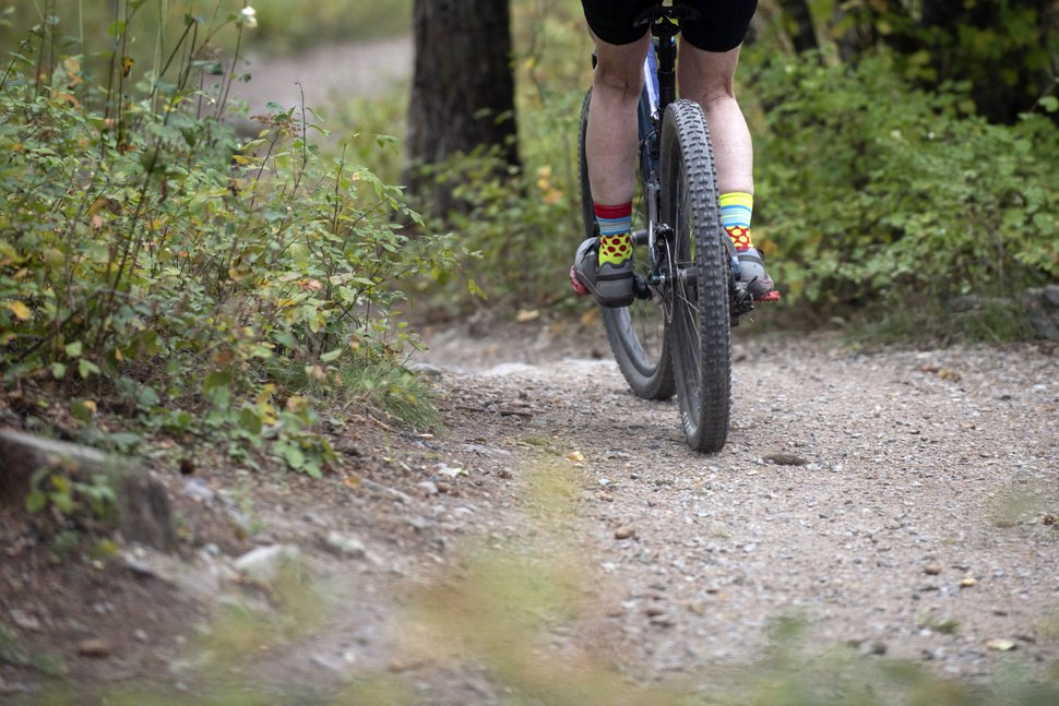 (Lido Vizzutti | The New York Times) A mountain biker rides a section of the Whitefish Trails west of Whitefish, Mont., north of Missoula, Oct. 3, 2019. Conservationists worry that the popularity of recreational mountain biking and electric bikes on public lands will lead to unsafe conditions for humans, as well as for bears and other wildlife.