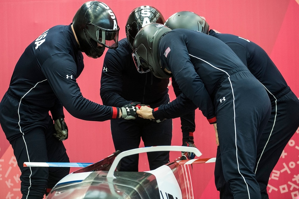 (Chris Detrick | The Salt Lake Tribune) USA's Justin Olsen, Nathan Weber, Carlo Valdes and Chris Fogt huddle during the 4-man Official Training at Olympic Sliding Centre during the Pyeongchang 2018 Winter Olympics Wednesday, Feb. 21, 2018.
