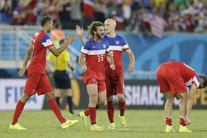 United States players United States' Kyle Beckerman, centre left and teammate Michael Bradley, centre right celebrate after the group G World Cup soccer match between Ghana and the United States at the Arena das Dunas in Natal, Brazil, Monday, June 16, 2014.  The United States won the match 2-1.  (AP Photo/Ricardo Mazalan)