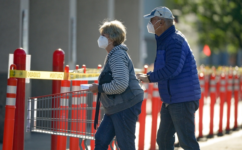 (Francisco Kjolseth | The Salt Lake Tribune) Costco begins implementing a policy on Monday, May 4, 2020, that everyone in the store, including shoppers, have to wear a mask, as people shop early in Salt Lake City during the coronavirus pandemic.