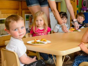 (Trent Nelson  |  The Salt Lake Tribune) Chelsie Stain serves lunch to children at Imagination Time Childcare and Preschool in Marriott-Slaterville on Tuesday, May 12, 2020.