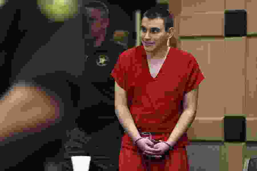 Hearing delayed on school shooting suspect's guard contact