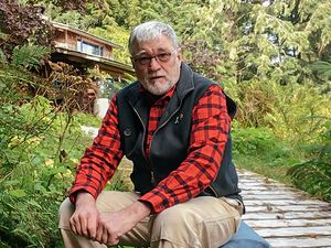 (Annie Tritt | The New York Times) Doug Leen, a retired backcountry dentist who collects and reproduces national park posters created by Works Progress Administration artists, at his home on Alaska's Kupreanof Island, Aug. 19, 2020. Leen has made it his life's work to track down as many of the original WPA national park posters as he can, after they were scattered across the country for 70 years with few records.