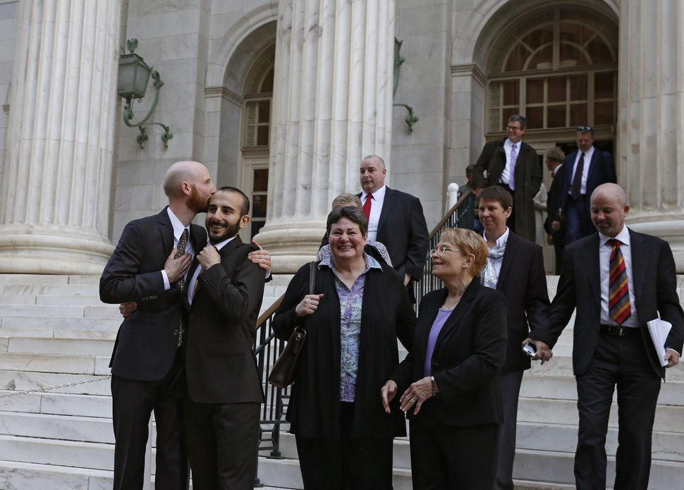 (Brennan Linsley | AP file photo) Plaintiffs and gay rights activists Derek Kitchen, left, and his partner Moudi Sbeity embrace as they leave court with other gay rights supporters after a hearing at the U.S. Circuit Court of Appeals in Denver, Thursday, April 10, 2014.