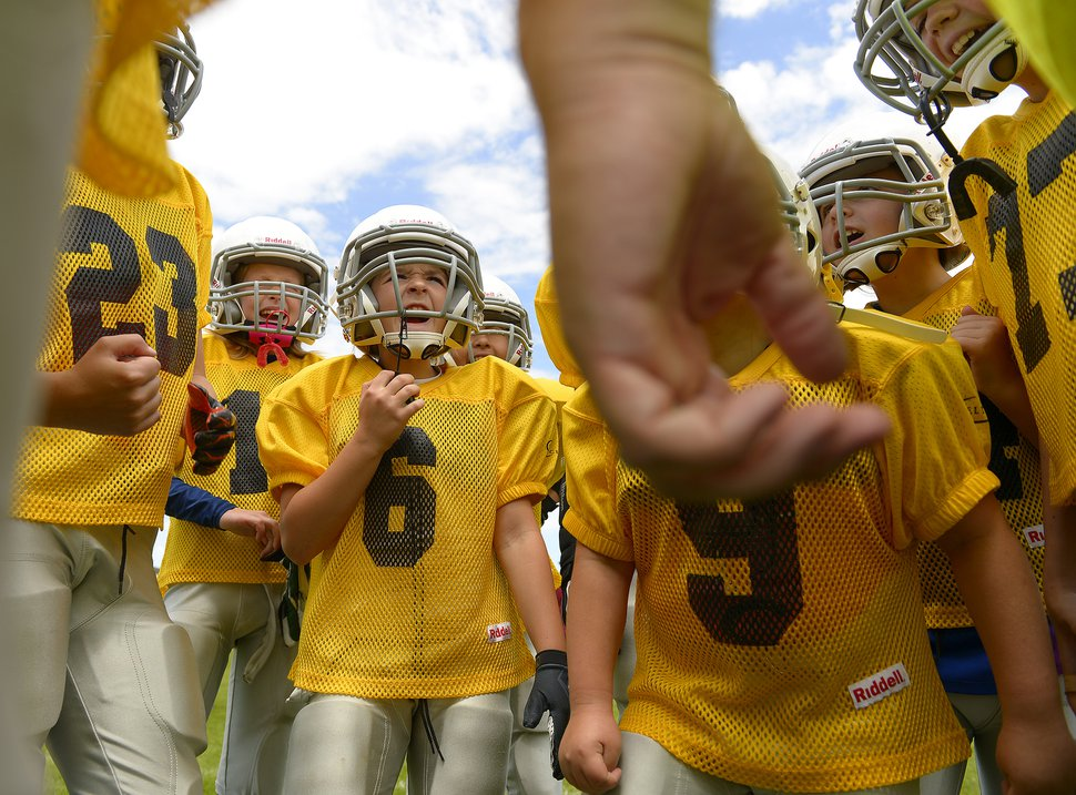 Photography by Leah Hogsten Sam Gordon #6 cheers with her Yellowjackets team members during half time of their game with the Rebels. Utah Girls Tackle Football League play two games at Mountain Shadows Elementary in West Jordan Saturday, May 30, 2015.
