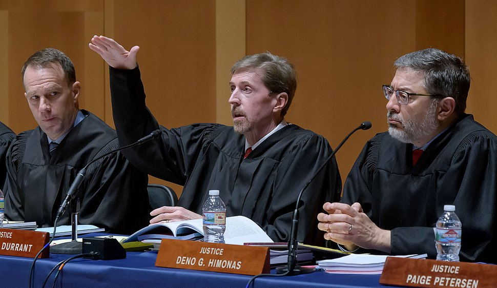 (Eli Lucero | Pool photo) Chief Justice Matthew Durrant, center, asks a question as Associate Chief Justice Thomas Lee, left, and Justice Deno Himonas listen, during the oral arguments of State v. Van Huizen on Monday, March 19, 2018, in Logan. The Utah Supreme Court has yet to rule on a crucial election case in Holladay, even as Election Day is fast approaching.