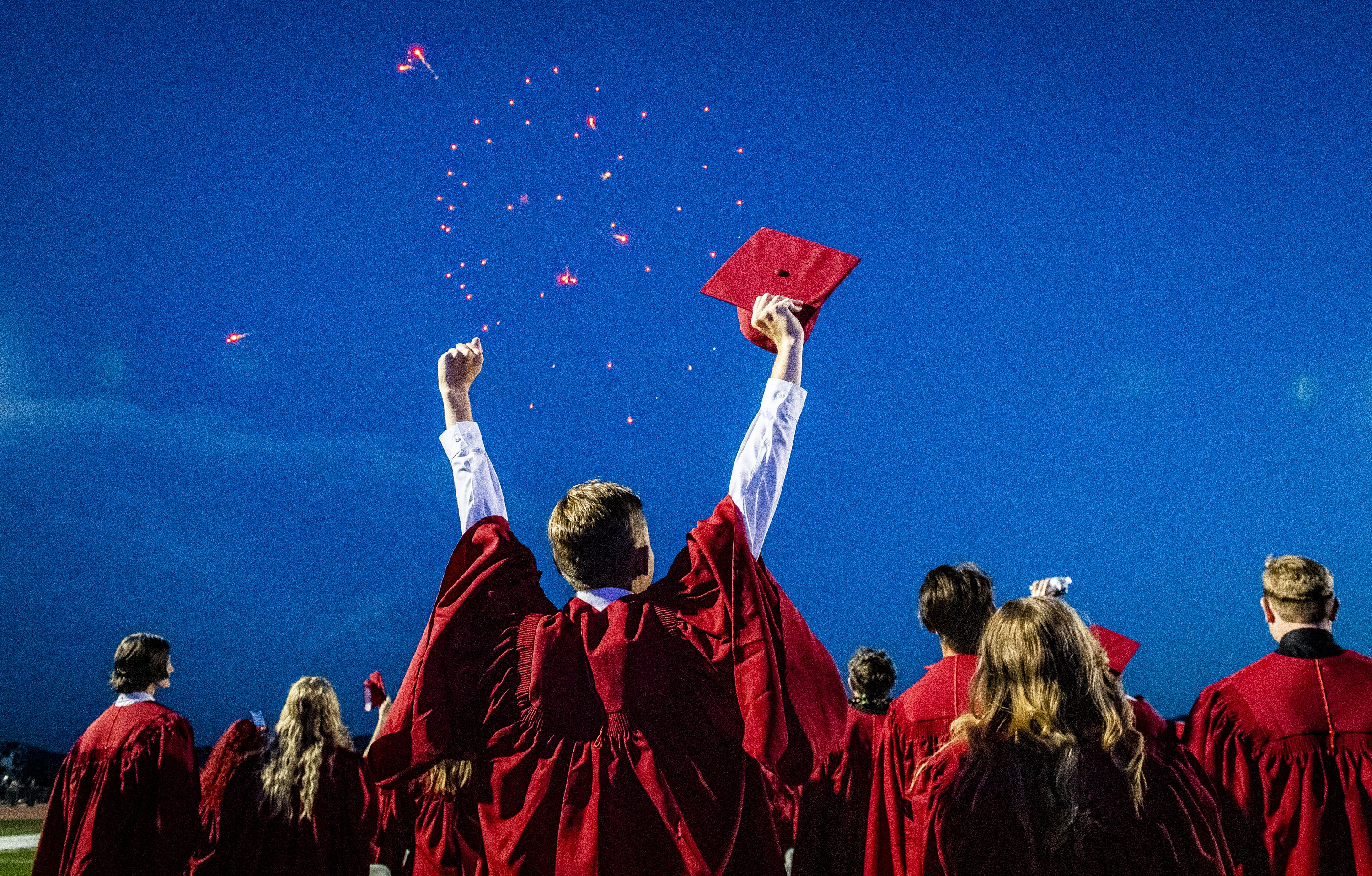 (Isaac Hale | Special to The Tribune) Graduates celebrate during the fireworks show at the end of Herriman High School's graduation ceremony held Thursday, June 3, 2021.