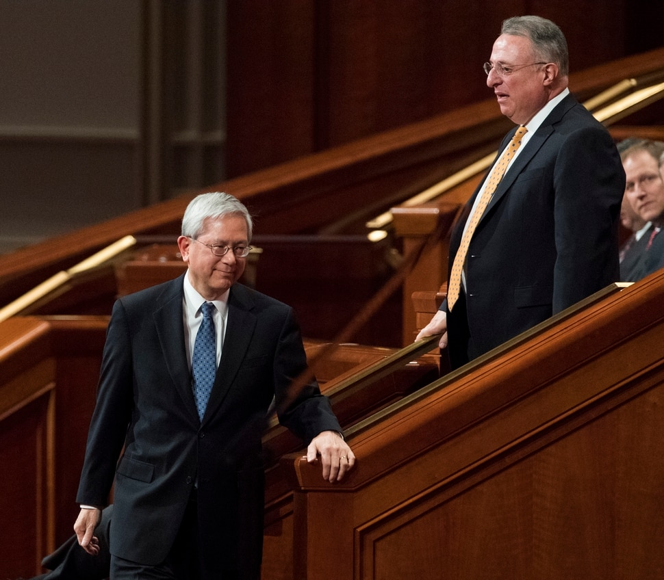 (Rick Egan | The Salt Lake Tribune) Gerrit W. Gong and Ulisses Soares leave their seats to join the quorum of the 12 apostles, during the morning session of the 188th Annual General Conference in Salt Lake City, Saturday, March 31, 2018.