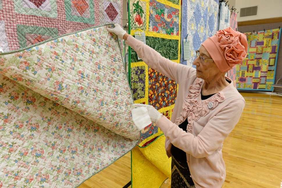 (Francisco Kjolseth | The Salt Lake Tribune) Nacele Hart overlooks her more than 100 quilts and numerous sewing projects created over a 10-year period for her children, grandchildren and great-grandchildren. On Friday at a church in Orem her family put them on display with plans to hand them out Saturday to her loved ones. She's also currently battling cancer.