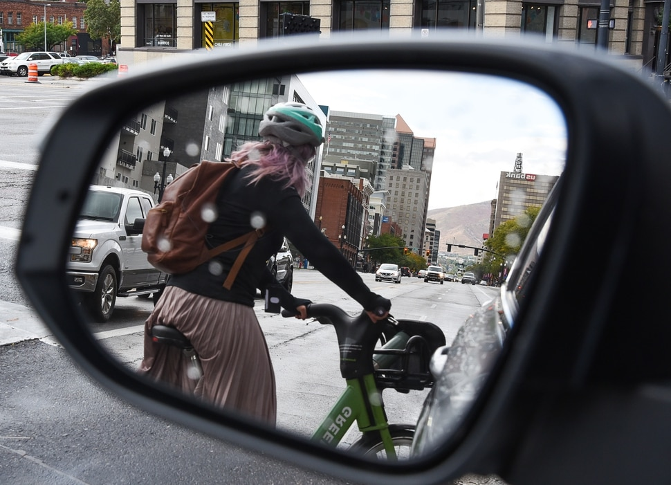 (Francisco Kjolseth | The Salt Lake Tribune) A GreenBike rider moves around traffic in downtown Salt Lake City on Tuesday, Oct. 2, 2108. GreenBike was on track to have their best year yet but then Lime and Bird scooters derailed their momentum.
