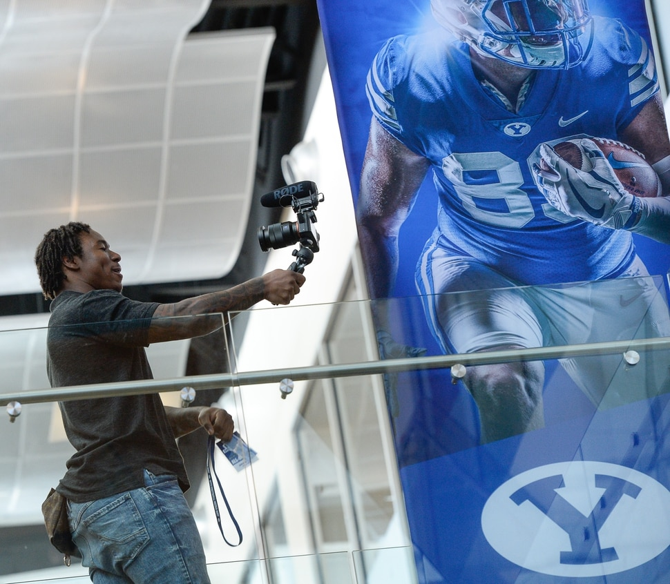(Francisco Kjolseth | The Salt Lake Tribune) Former BYU football player Jamaal Williams, now with the Green Bay Packers works the selfie camera during media day at the BYU-Broadcasting Building on Friday, June 22, 2018.