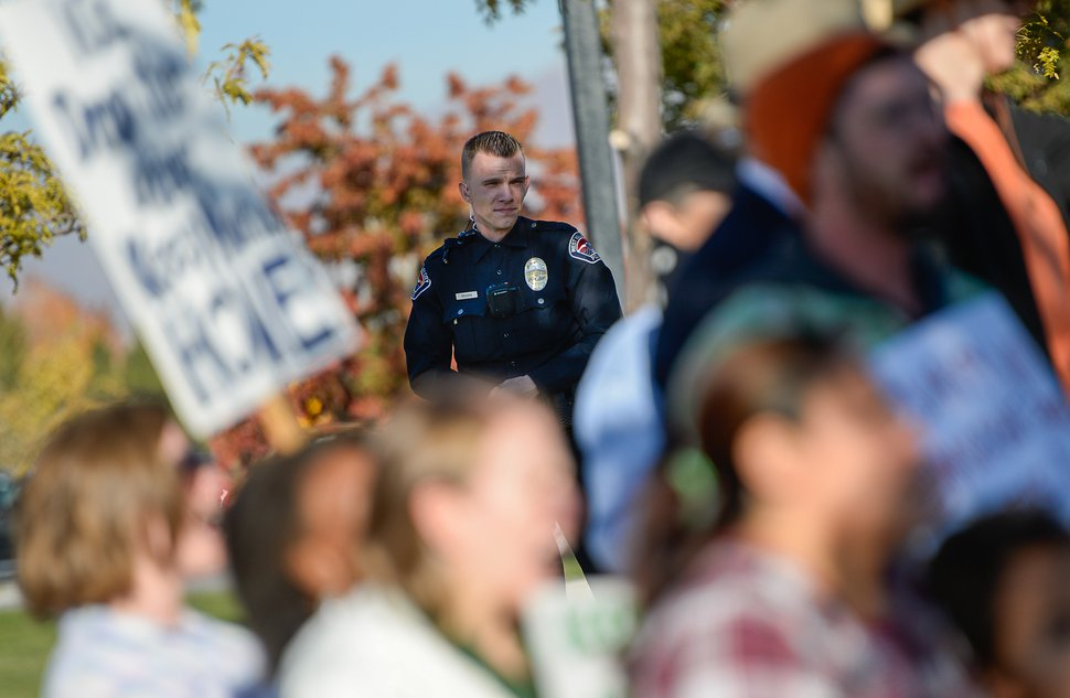 (Francisco Kjolseth | The Salt Lake Tribune) Police keep a watchful eye as community members rally in front of the Immigration and Customs Enforcement offices in West Valley City on Monday, Oct. 16, 2017, to support Maria Santiago Garcia, a single Utah mother of four U.S. born children who faces an impending deportation order.