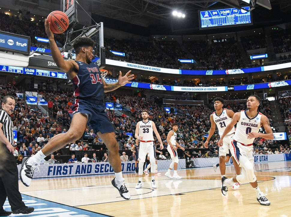 (Francisco Kjolseth | The Salt Lake Tribune) Fairleigh Dickinson Knights forward Mike Holloway Jr. (34) manages to keep the ball in play as Gonzaga faces Fairleigh Dickinson in their first round menÕs NCAA March Madness tournament game at Vivint Smart Home Arena in Salt Lake City on Thursday, March 21, 2019.