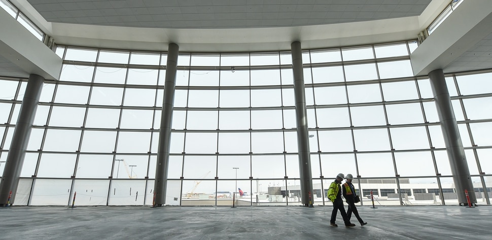 (Francisco Kjolseth | The Salt Lake Tribune) The Terminal Plaza towers above those gathered as Salt Lake City International Airport announces food concessionaires for the first phase of the new expanded airport during a tour on Wed. Feb. 20, 2019.