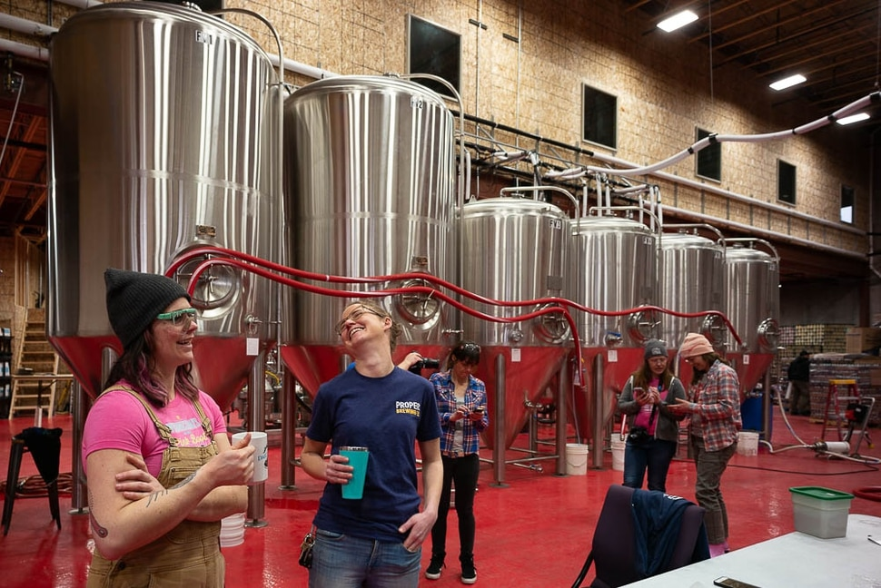 "(Trent Nelson | The Salt Lake Tribune) Jacquie King and Eleanor Lewis. Top female brewers from across the state gathered at Roosters Brewing Co in Ogden on Friday March 8, 2019 — International Women's Day — to brew ""On Wednesdays We Wear Pink Boots Cold IPA."