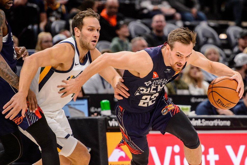 (Trent Nelson | The Salt Lake Tribune) Adelaide 36ers forward Anthony Drmic (22) drives around Utah Jazz forward Bojan Bogdanovic (44) as the Utah Jazz host the Adelaide 36ers, NBA basketball in Salt Lake City on Saturday Oct. 5, 2019.