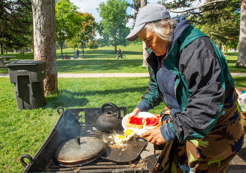 (Rick Egan | The Salt Lake Tribune) Rosie Webster cooks some eggs and toast at Liberty Park, Saturday, May 23, 2020.