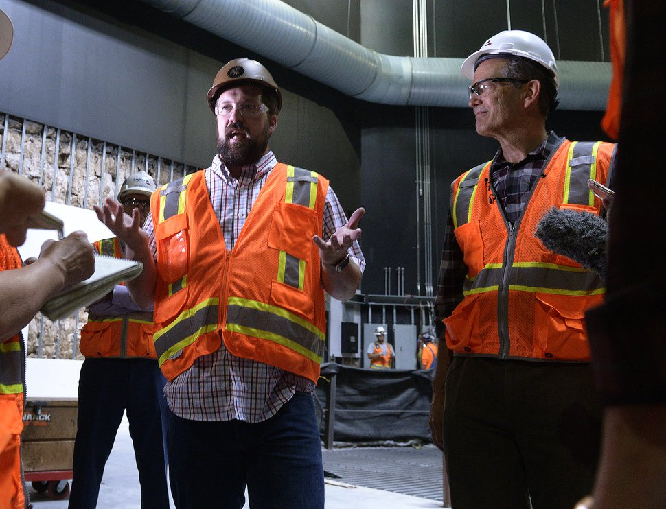 (Leah Hogsten | The Salt Lake Tribune) l-r Hale Centre Theatre Production Designer Kacey Udy and CEO Mark Dietlein gives details about the theatre's stage automation and components that raise, lower, rotate and slide along with custom flying systems located high above the Centre Stage floor, August 8, 2017.