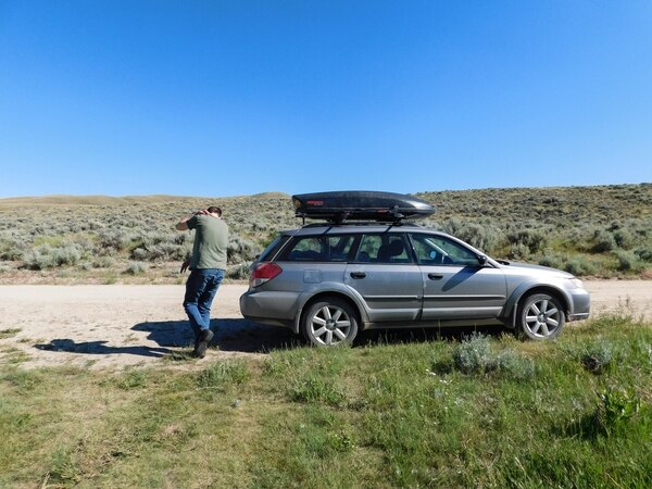 Erin Alberty | The Salt Lake Tribune Scenes from the Oregon Trail: Craig Buschmann takes cover from swarming deer flies at Willow Springs Ñ the supposedly-sought-after campsite for pioneers on the Oregon Trail west of Casper.