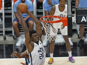 (Rick Bowmer  |  Associated Press) Utah Jazz's Udoka Azubuike (20) dunks against the Memphis Grizzlies during the first half of an NBA summer league basketball game Wednesday, Aug. 4, 2021, in Salt Lake City.