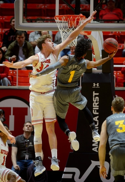 (Steve Griffin | The Salt Lake Tribune) Utah Utes forward Jayce Johnson (34) contests the shot of Arizona State Sun Devils guard Remy Martin (1) during the Utah Utes versus Arizona State Sun Devils at the Huntsman Center on the University of Utah campus in Salt Lake City Sunday January 7, 2018.