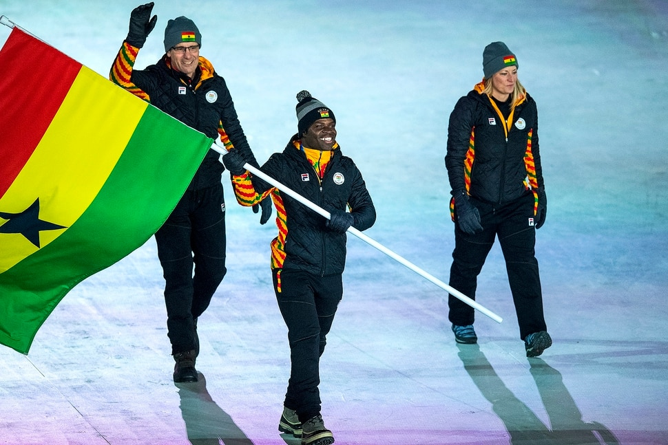 (Chris Detrick | The Salt Lake Tribune) Former Utah Valley University sprinter Akwasi Frimpong carries the flag of Ghana during the Pyeongchang 2018 Winter Olympics opening ceremony at Olympic Stadium Friday, February 9, 2018.
