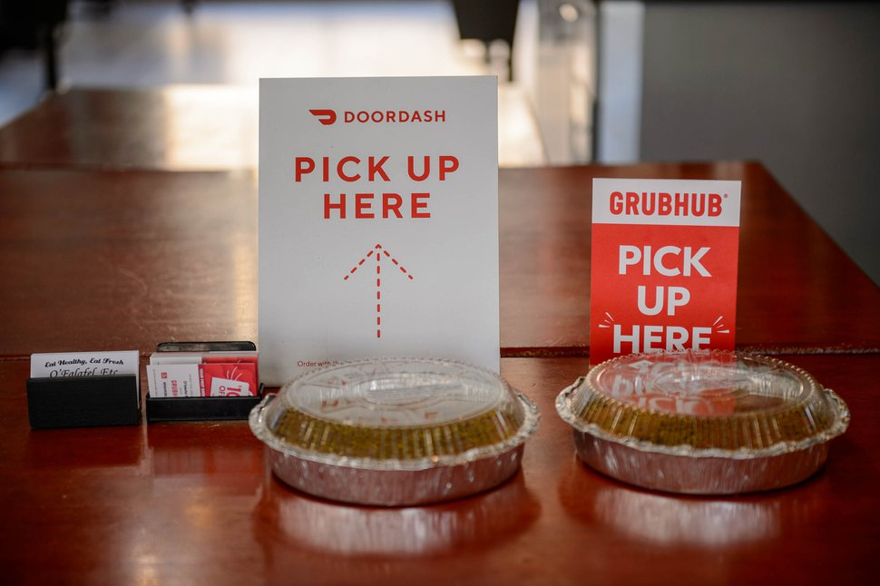 (Trent Nelson | The Salt Lake Tribune) Signs for DoorDash and Grubhub delivery drivers at O'Falafel in Salt Lake City on Friday, July 17, 2020.