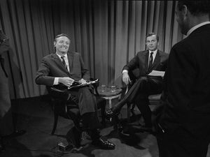 """(Courtesy Magnolia Pictures) Conservative William F. Buckley (sitting on the left) smiles as he and liberal Gore Vidal prepare for one of their televised debates for ABC during the 1968 political conventions. The events are chronicled in the documentary """"Best of Enemies."""""""