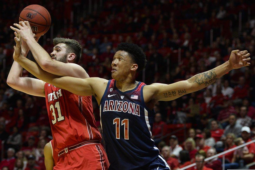 Utah center Brandon Morley (31) fights for the ball with Arizona forward Ira Lee (11) during the first half of an NCAA college basketball game Thursday, Feb. 14, 2019, in Salt Lake City. (AP Photo/Alex Goodlett)