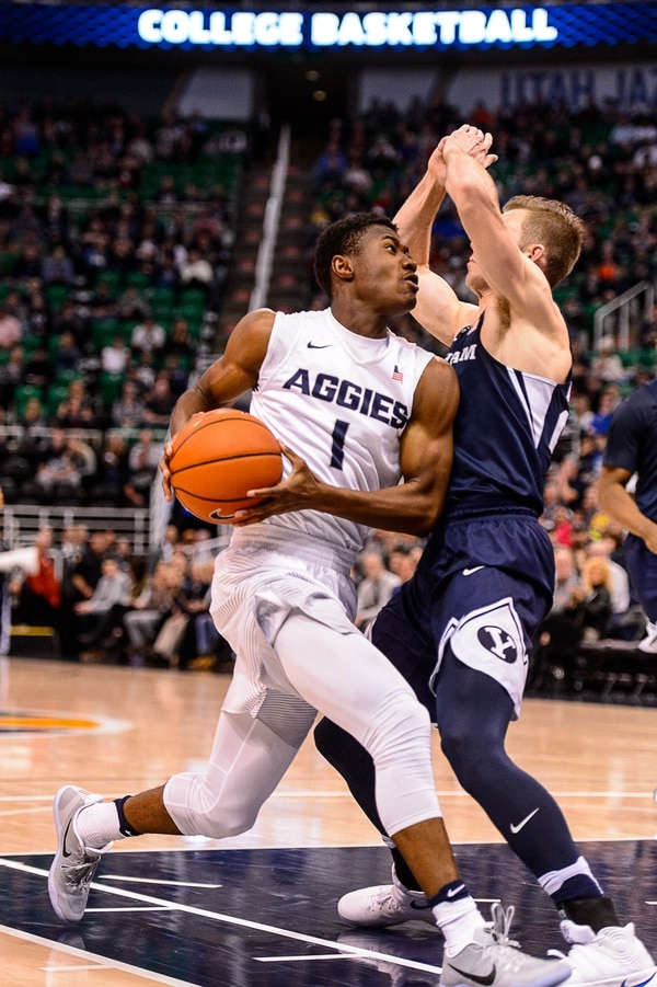 Trent Nelson | The Salt Lake Tribune Utah State Aggies guard Koby McEwen (1) drives on Brigham Young Cougars forward Davin Guinn (24) as BYU faces Utah State, NCAA basketball in Salt Lake City, Wednesday November 30, 2016.