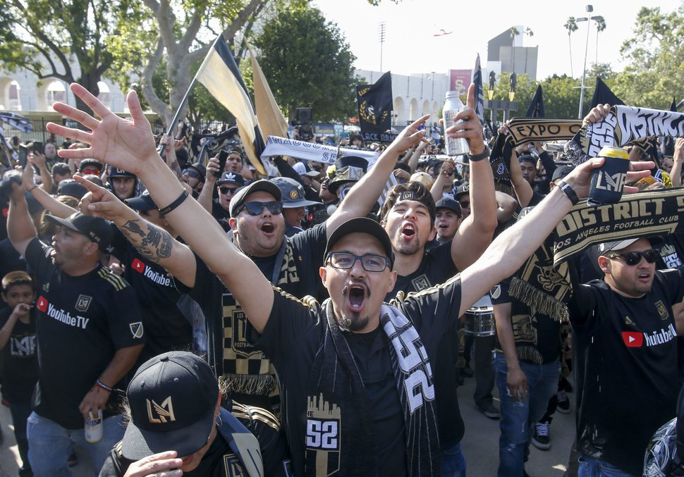 Fans of Los Angeles FC march outside the new Banc of California Stadium before an MLS soccer game against the Seattle Sounders in Los Angeles, Sunday, April 29, 2018. (AP Photo/Ringo H.W. Chiu)