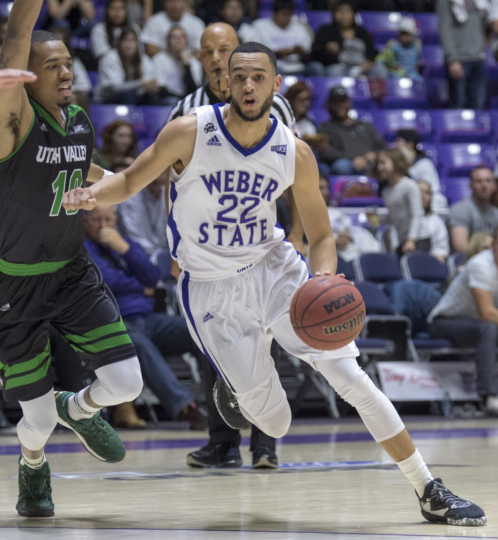 Rick Egan | The Salt Lake Tribune Weber State Wildcats guard Ryan Richardson (22) takes the ball inside, in basketball action, Weber State Wildcats vs Utah Valley Wolverines, in Ogden, Saturday, December 17, 2016.