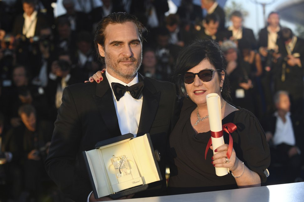 Directors Lynne Ramsay, right, with her joint Best screenplay award and actor Joaquin Phoenix with his Best Actor award both for the film You Were Never Really Here, pose for photographers during a photo call following the awards ceremony at the 70th international film festival, Cannes, southern France, Sunday, May 28, 2017. (Photo by Arthur Mola/Invision/AP)