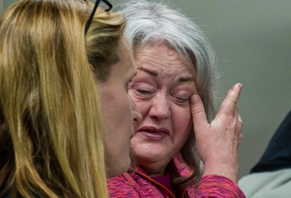 (Rick Egan | The Salt Lake Tribune) Karen Haslam wipes a tear from her eye, after the Granite School District's Board of Education voted to close Westbrook Elementary school, where she teaches, Tuesday, Dec. 3, 2019.