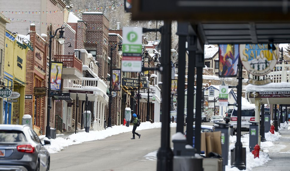 (Leah Hogsten | Tribune file photo) People walk Main Street in Park City, Friday, March 27, 2020. Economic activity plunged in the resort town due to the coronavirus.