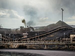 (Francisco Kjolseth  |  Tribune file photo) This Tribune file photo from 2017 shows crews moving coal at the Levan transfer facility along Interstate 15, south of Nephi, where a steady flow of trucks unload it before it is transferred to train cars bound for export terminals in California. Utah has joined industry lawsuits seeking to invalidate a coal ban enacted by the city of Richmond, a key port city where Utah coal is shipped to Japan.