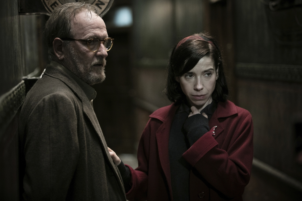 This image released by Fox Searchlight Pictures shows Richard Jenkins, left, and Sally Hawkins in a scene from the film The Shape of Water. (Fox Searchlight Pictures via AP)