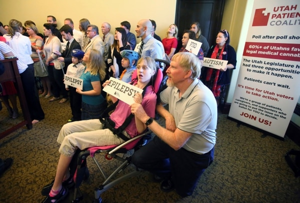 Rick Bowmer | AP Photo Doug Rice, right, and his daughter Ashley, left, look on with other patients, caregivers and supporters during the Utah Patients Coalition news conference at the Utah State Capitol Monday, June 26, 2017, in Salt Lake City. A group of activists and Utah residents with chronic conditions has launched a ballot initiative to ask voters next year to pass a broad medical marijuana law.