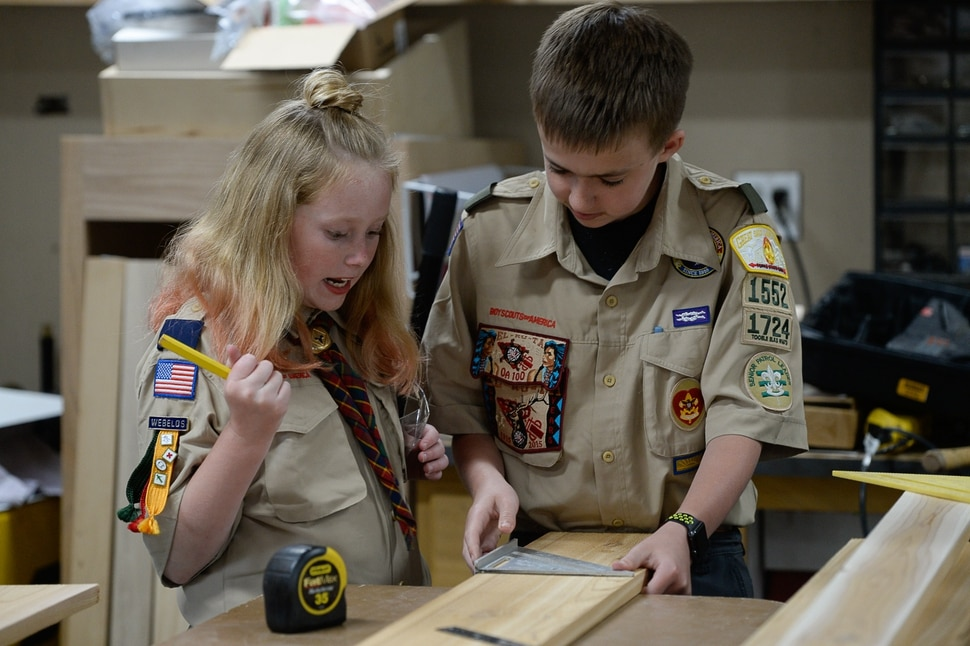 (Francisco Kjolseth | The Salt Lake Tribune) Miriam Cook, 11, helps her brother Kolbie, 12, with his Eagle Scout project as they assemble bird houses in the family garage in Tooele on Monday, May 14, 2018. Miriam, who is one of the early adopters into the Cub Scouts, has always been interested in the things her brother did in Scouting. Her goal is to earn her Arrow of Light, the bridge between Cub Scouts and Boy Scouts (which will change its name to Scouts BSA next February).