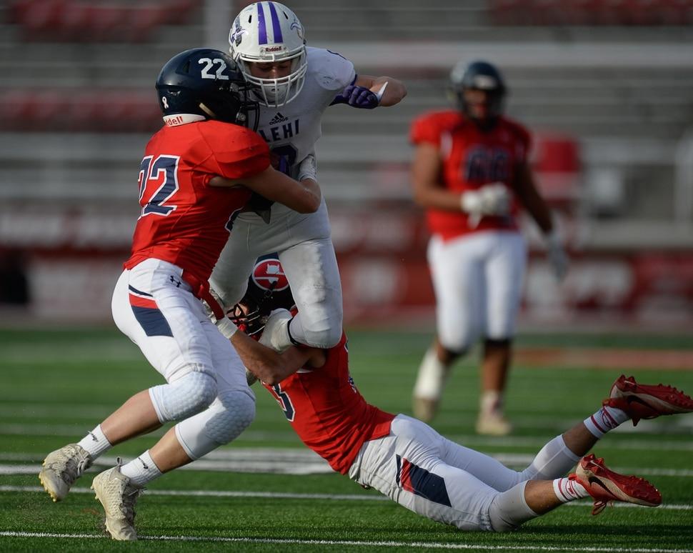 (Francisco Kjolseth   The Salt Lake Tribune) Carsen Manookin of Lehi battles the Springville defense in the second quarter of their class 5A state semifinal game at Rice-Eccles Stadium, Thursday, Nov. 9, 2017.