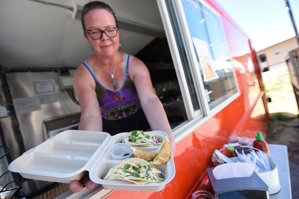 (Francisco Kjolseth | The Salt Lake Tribune) Co-owner Amy Dunyon serves Tokyo tacos from the Umai food truck, which specializes in Asian street food.