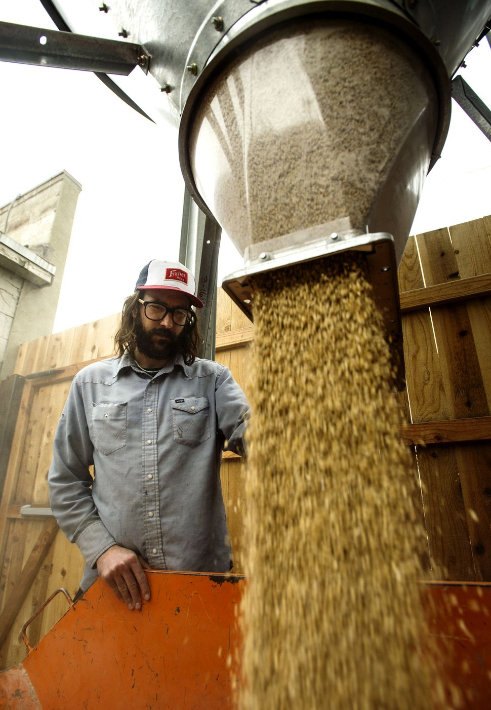Steve Griffin | The Salt Lake Tribune Colby Frazier prepares some grain at the new A. Fisher Brewing Company in Salt Lake City Friday February 17, 201. The brewery is one of the oldest names in Utah beer history. The brewery makes a modern-day comeback this month. Tom Fisher Riemondy, one of five partners who have resurrected A. Fisher Brewing Company, is the great, great grandson of Albert Fisher, a German immigrant who founded the original brewery in Utah in 1884. The brewery survived prohibition and flourished through the early 20th century, becoming one of the largest breweries to produce beer in the Intermountain West. In 1960, after a series of acquisitions by larger breweries, the label disappeared.