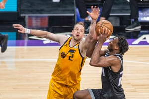Utah Jazz guard Joe Ingles (2) defends Sacramento Kings guard Buddy Hield (24) as he goes to the basket during the first quarter of an NBA basketball game in Sacramento, Calif., Wednesday, April 28, 2021. (AP Photo/Hector Amezcua)