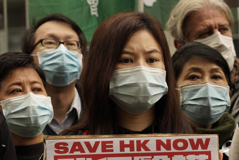 (Vincent Yu | The Associated Press) Medical staff strike over coronavirus concerns outside government headquarters in Hong Kong, Wednesday, Feb. 5, 2020.